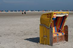 Hooded beach chairs. Signed with an M Royalty Free Stock Photography
