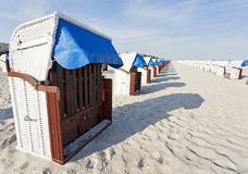 Hooded beach chairs at the baltic sea Stock Photos