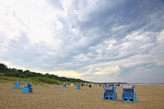 Hooded beach chairs at the Baltic sea in Heringsdorf, Germany Royalty Free Stock Photography