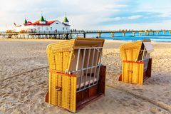 Hooded beach chairs at the pier in Ahlbeck, Germany. Hooded beach chairs at the famous pier of the Baltic Sea resort Ahlbeck, Germany Royalty Free Stock Images