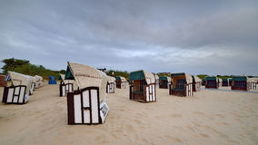 Hooded beach chairs (strandkorb) at the Baltic Royalty Free Stock Photo