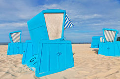 Hooded beach chairs (strandkorb) at the Baltic seacoast. In Swinoujscie city, Poland Royalty Free Stock Images