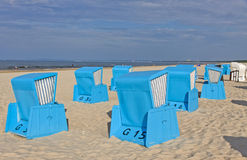 Hooded beach chairs (strandkorb) at the Baltic seacoast. In Swinoujscie, Poland Royalty Free Stock Image