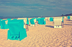 Hooded beach chairs (strandkorb) at the Baltic seacoast Stock Image