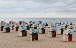 Hooded beach chairs (strandkorb) at the Baltic seacoast Royalty Free Stock Photo