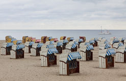 Hooded beach chairs (strandkorb) at the Baltic seacoast. In Travemunde, Germany Royalty Free Stock Images