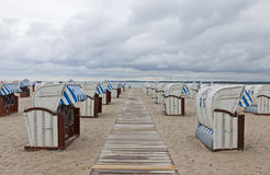 Hooded beach chairs (strandkorb) at the Baltic seacoast. In Travemunde, Germany Stock Photos