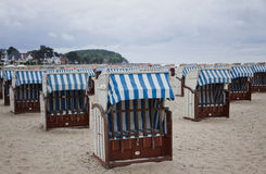 Hooded beach chairs (strandkorb) at the Baltic seacoast. In Travemunde, Germany Royalty Free Stock Image