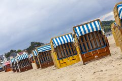 Hooded beach chairs strandkorb at Baltic seacoast in Travemunde, Germany royalty free stock image