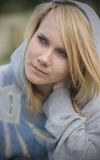 Hooded blond girl portrait Royalty Free Stock Photography