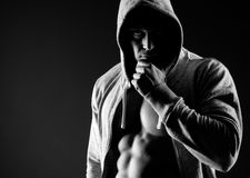 Hooded body builder Royalty Free Stock Photo