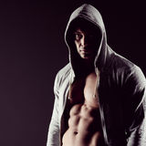Hooded body builder Royalty Free Stock Photography