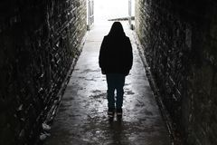 Hooded boy in an underground tunnel Royalty Free Stock Photo