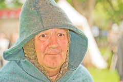 Hooded character at Marymas Fair. Stock Images