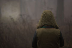 Hooded character surrounded by fog Stock Photos