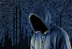 Hooded computer hacker Stock Photography