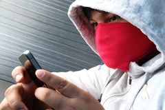 Hooded cyber crime hacker using mobile phone internet hacking. In to cyberspace,online personal data security concept Stock Images