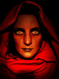 Hooded Evil Woman Portrait. A digitally altered photo portrait featuring a hooded figure. This image could be used in so many different themes royalty free illustration