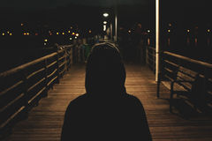 Hooded figure at night Royalty Free Stock Images