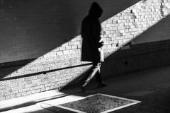 Hooded man in shadow Royalty Free Stock Photos