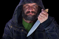 Hooded frightening man with dirty face and big knife Royalty Free Stock Images