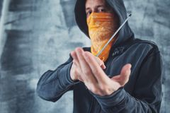 Hooded gang member criminal with screwdriver royalty free stock photography