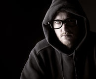 Hooded Geeky Male. Low Key Shot of a Hooded Geeky Male Stock Photo
