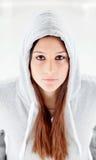 Hooded girl with grey sweatshirt Royalty Free Stock Image