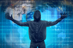 Hooded hacker with anonymous mask. Against binary code in background stock photo