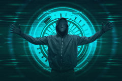 Hooded hacker with anonymous mask expression. Against digital background stock photography