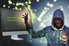 The hooded hacker in data computer security concept. Hooded hacker in data computer security concept Royalty Free Stock Photos