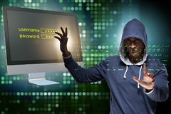 The hooded hacker in data computer security concept. Hooded hacker in data computer security concept Royalty Free Stock Photography