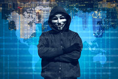 Hooded hacker with mask working out Stock Photos