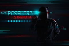 Hooded hacker in password strength concept royalty free stock images