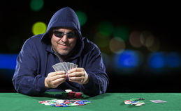 Hooded Male Poker Player with Cards Stock Image