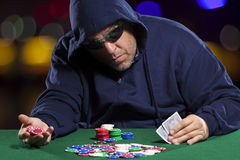 Hooded Male Poker Player with Cards Stock Photos