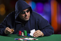 Hooded Male Poker Player with Cards Stock Photography