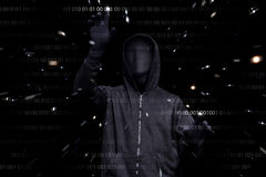 Hooded man with anonymous mask hacking binary system security co Stock Image