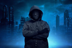Hooded man with anonymous mask standing Royalty Free Stock Photo