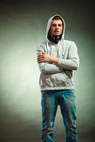 Hooded man with big headphones on neck Royalty Free Stock Images