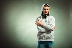Hooded man with big headphones on neck Royalty Free Stock Photo