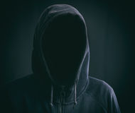 Hooded man on black background royalty free stock photo