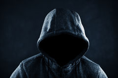 Hooded man. In the dark Stock Images