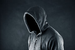 Hooded man. In the dark Royalty Free Stock Image
