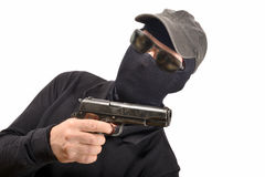 Hooded man with a gun Royalty Free Stock Photos
