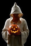 Hooded Man and Jack-0-Lantern Royalty Free Stock Photo