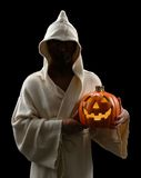 Hooded Man With Jack-o-Lantern stock image