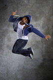 Hooded Man Jumping Stock Images