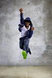 Hooded Man Jumping and Punching Royalty Free Stock Photos