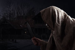 Hooded man with knife Royalty Free Stock Image